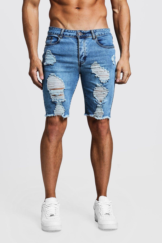 Зауженные длинные джинсовые шорты с необработанным краем